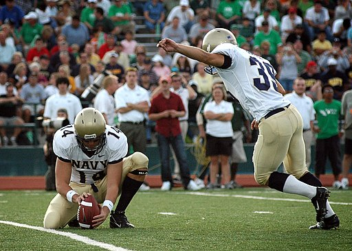 Navy Midshipmen kicking a field goal.