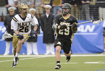 Army and Navy lacrosse midfielders running down the field