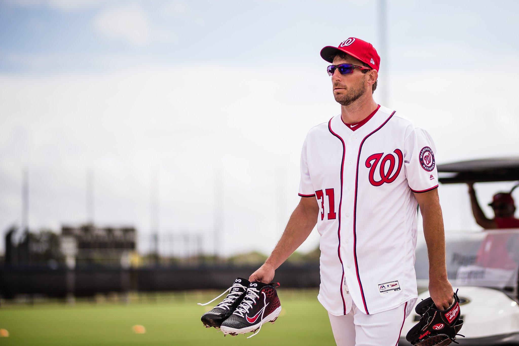 Max Scherzer walking on a baseball field