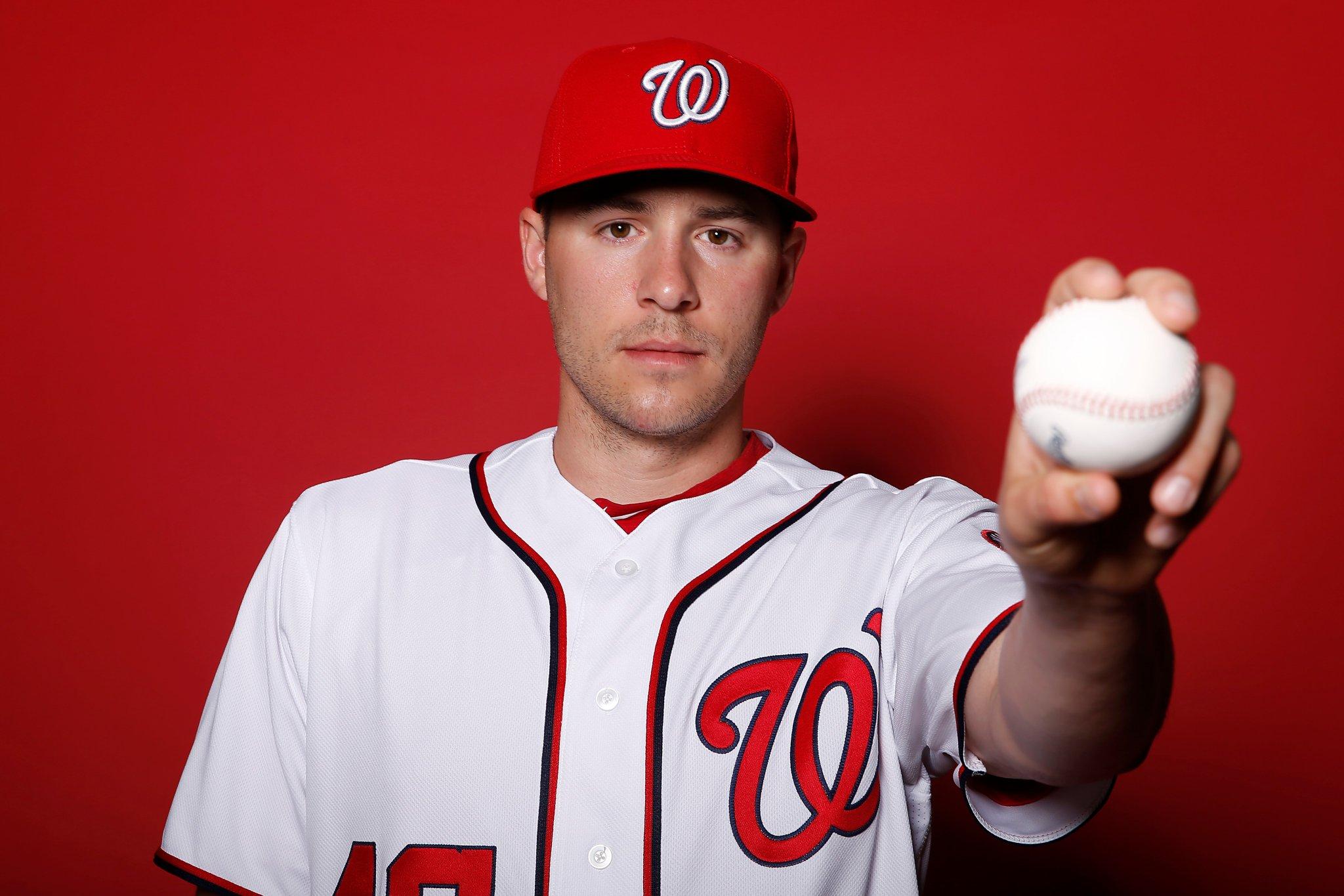 Patrick Corbin holding a baseball